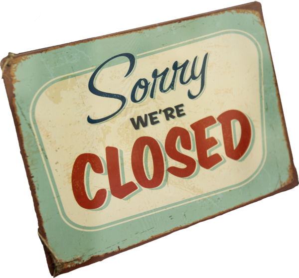 Retro styled sign displaying the words Sorry, we're closed
